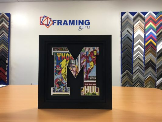 Framed Wallpaper cut to Initial with our Computerised Mount-cutter