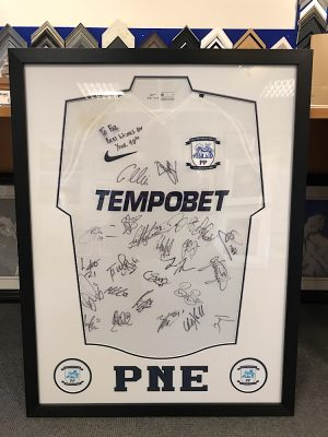 Preston North End Signed Shirt with badges and text cut out.